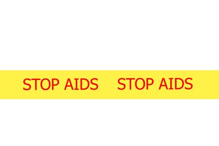 Yellow tape with  slogan STOP AIDS on white background photo