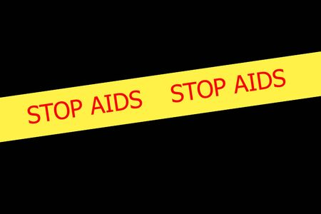 Yellow tape with  slogan STOP AIDS on black background photo