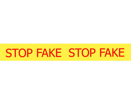 Yellow tape with  slogan STOP FAKE on white background photo