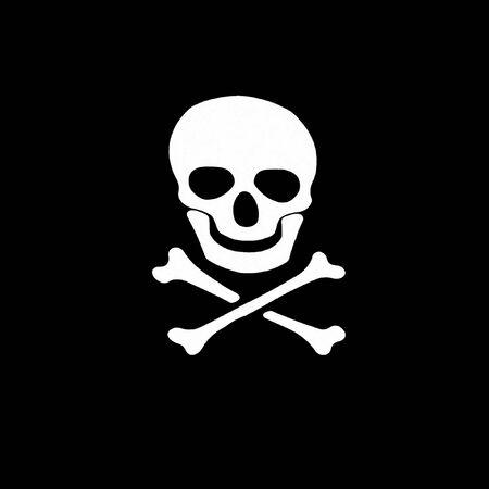 White skull and crossbones symbol wish shadow on black background  photo