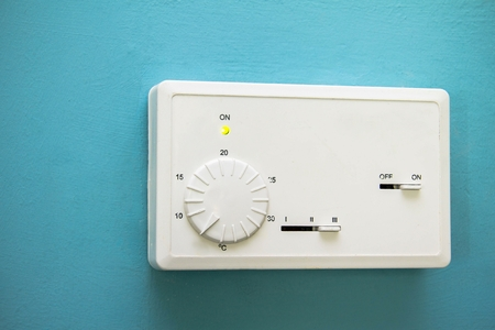 Old wall-mounted remote control air conditioner in hotel
