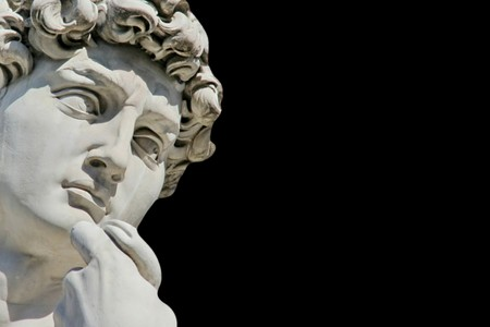Detail close-up of Michelangelo's David statue on black background, with place for your design or text Foto de archivo