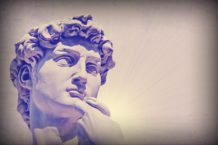 Grunge detail  of Michelangelo's David statue  with the effect of the color purple haze and  place for your design or text