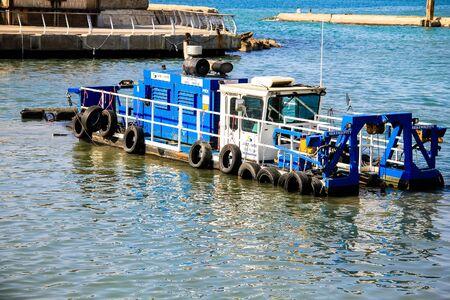 dredge: Dredge in the old port at Mediterranean sea. Tel Aviv.Israel Stock Photo
