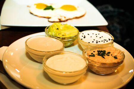 israeli: Israeli breakfast  with   Hummus, Tahini, avocado salad on foreground Stock Photo