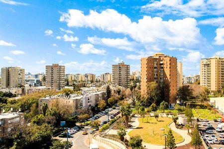 ramat aviv: Clouds  over Tel Aviv skyline at Sunny Day