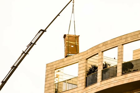 penthouse: Delivery of the refrigerator in  original packaging to the penthouse via truck crane