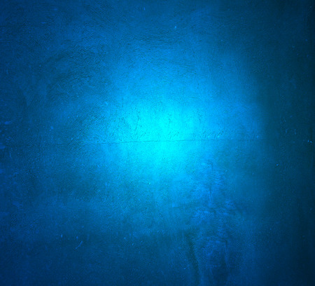 painted background: Blue plaster pattern  background with spotlight and  place for your design or text