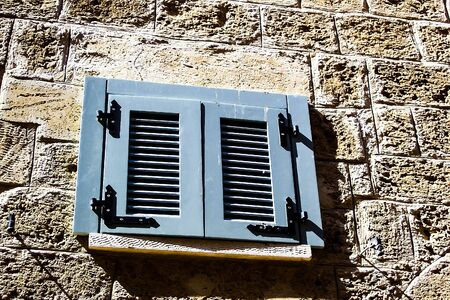 jewish home: Windows with shuttered  in stone wall of  Old Jaffa