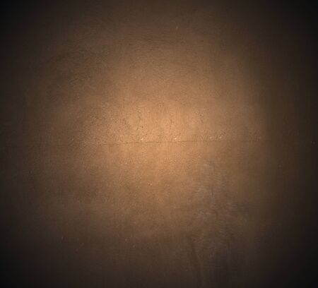 hued: Brown painted  plaster pattern  background with spotlight and  place for your design or text