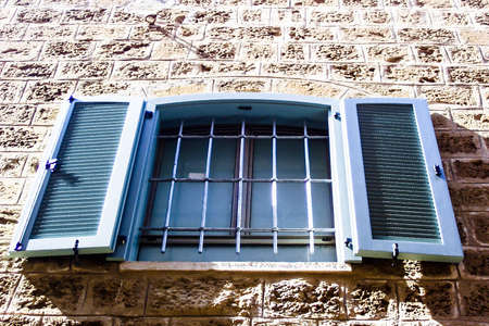 jewish home: Windows with shuttered  in stone wall of  Old Jaffa. Israel Stock Photo