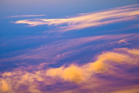 incarnadine: View above the clouds on beautiful crimson sunset. Useful as background in your projects Stock Photo