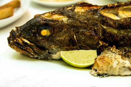 epinephelus: Grouper baked in the oven at the banquet table
