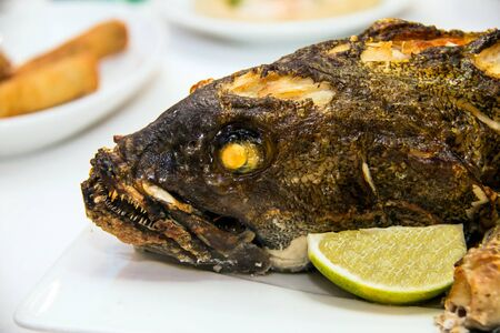 pikeperch: Grouper baked in the oven at the banquet table
