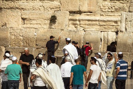 bar mitzvah: Unidentified Jews spend Bar Mitzvah ceremony near Western Wall. A man carries a 13-year-old boy on his shoulders. Jerusalem. Israel