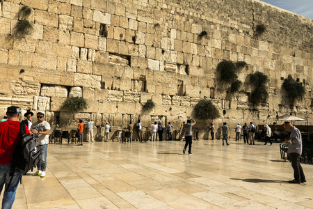 Unidentified jewish worshipers pray at the Wailing Wall an important jewish religious site. Jerusalem. Israel