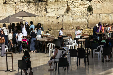 jewish group: Unidentified Jews women watching through the fence to the female sector of the  conduct Bar Mitzvah ceremony near Western Wall. Jerusalem. Israel