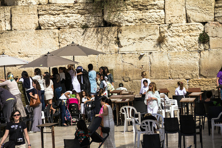 mitzvah: Unidentified Jews women watching through the fence to the female sector of the  conduct Bar Mitzvah ceremony near Western Wall. Jerusalem. Israel
