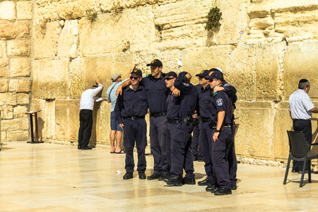 mishnah: Group  of unidentified   young Israelis in police uniform are doing a picture in memory of the visit to the Wailing Wall. Jerusalem. Israel