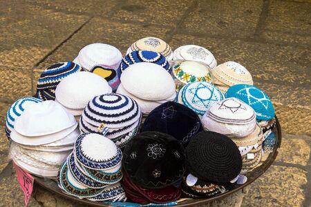 yarmulke: Jewish religious caps yarmulke  on the stone pavement near  souvenir shop in the jewish quarter of the old city. Jerusalem. Israel