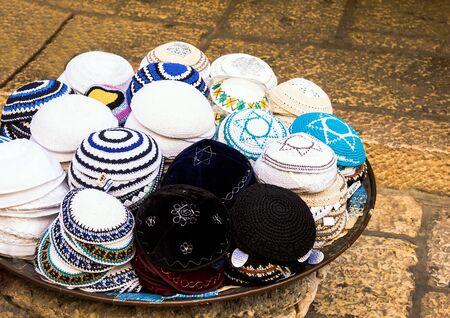 jewish quarter: Jewish religious caps yarmulke  on the stone pavement near  souvenir shop in the jewish quarter of the old city. Jerusalem. Israel