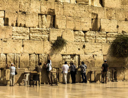 Unidentified jewish worshipers pray at the Wailing Wall an important jewish religious site . Jerusalem. Israel Editorial