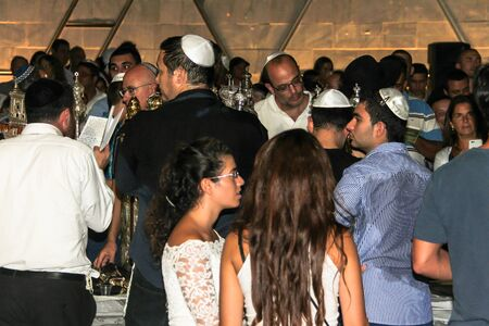 simchat torah: Unidentified jewish men praying on ceremony of Simhath Torah is a celebration marking the conclusion of the annual cycle of public Torah readings, and the beginning of a new cycle. Tel Aviv. Israel