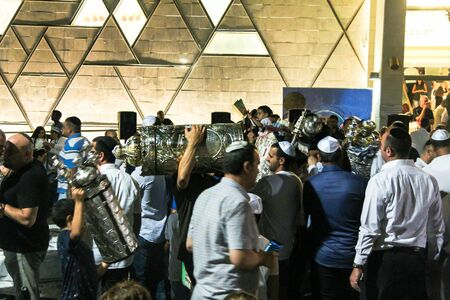 Unidentified jewish  dance with Bible scrolls during the ceremony of Simhath Torah. Tel Aviv. Israel