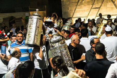 joyous festivals: Unidentified jewish people on ceremony of Simhath Torah with Chuppah. Tel Aviv. Israel
