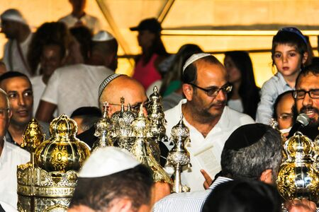 Unidentified jewish people on ceremony of Simhath Torah with Chuppah is a celebration marking the conclusion of the annual cycle of public Torah readings, and the beginning of a new cycle. Tel Aviv. Israel