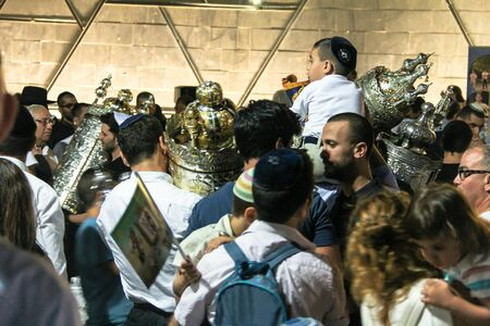 simchat torah: Unidentified jewish  dance with Bible scrolls during the ceremony of Simhath Torah is a celebration marking the conclusion of the annual cycle of public Torah readings, and the beginning of a new cycle. Tel Aviv. Israel