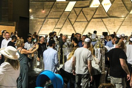 simchat torah: Unidentified jewish  people near Bible scrolls during the ceremony of Simhath Torah is a celebration marking the conclusion of the annual cycle of public Torah readings, and the beginning of a new cycle. Tel Aviv. Israel