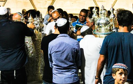 Unidentified jewish men praying on ceremony of Simhath Torah is a celebration marking the conclusion of the annual cycle of public Torah readings, and the beginning of a new cycle. Tel Aviv. Israel