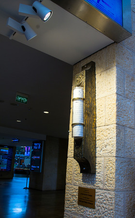 mezuzah: Big Mezuzah  at the stone wall in Ben Gurion AirportTaxiing aircraft Airbus A-320  after landing  in Heathrow Airport near  passenger jet airplane   on cloudy sky background. London. UK