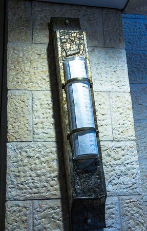 mezuzah: Big Mezuzah  at the stone wall in Ben Gurion Airport. Tel Aviv. Israel Editorial