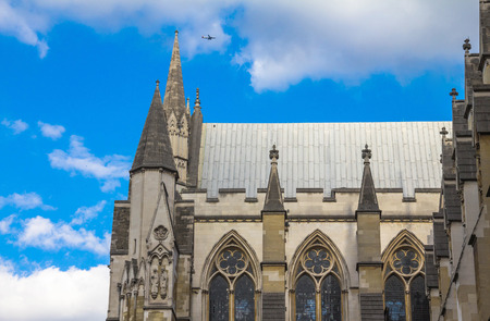 rectilinear: Westminster Abbey on blue summer cloudy sky background, London, UK