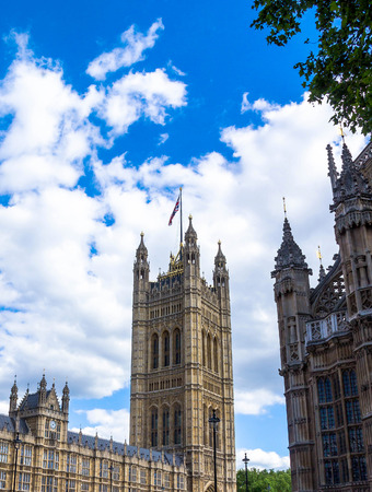 flag england: Westminster Palace Victoria Tower . London. UK Editorial