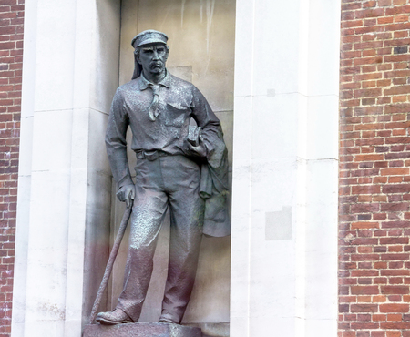 geographical: Statue of David Livingstone Explorer of Africa, missionary, writer and medic stands in a niche at the  wall of  Westminster palace Royal Geographical Building. London. UK. Erection date: October 23, 1953.