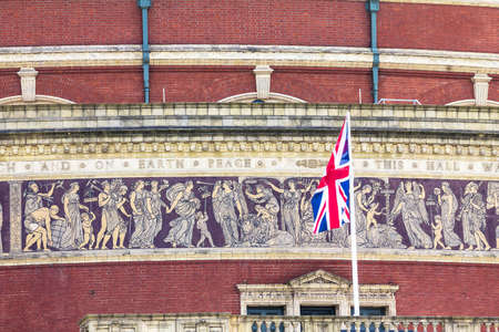 britannia: British flag  on Great mosaic frieze, depicting The Triumph of Arts and Scienceson the wall on Royal Albert Hall background in late afternoon daylight.  London, England, UK,