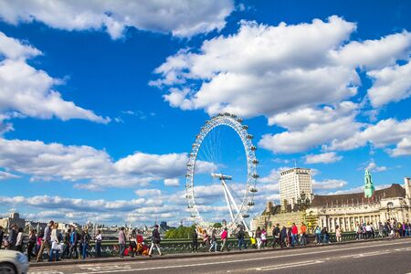 british touring car: Unidentified tourists and locals at Westminster Bridge on London eye and Monument  of Boudicca and her daughters background. London. UK