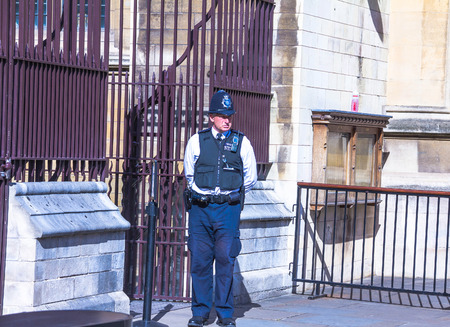 north end: Unidentified British policeman near the House of Parliament located in north end of the Palace of Westminster. London. UK Editorial