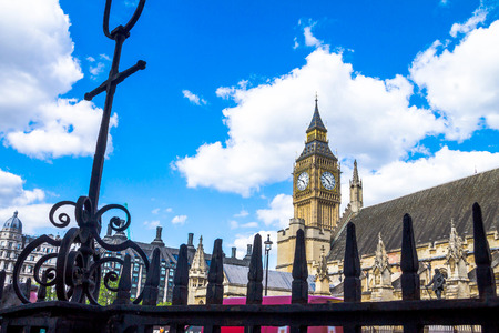 city of westminster: Palace of Westminster fragment (known as Houses of Parliament) with clock tower located on bank of River Thames in City of Westminster. London, UK.