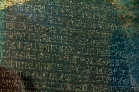 British Museum. Famous Rosetta stone, used by Jean-Franois Champollion to decipher the hieroglyphic writing. The text on the stone, created in 196 BC after the end of the Egyptian dynasties, is written in three different writings: Greek, hieroglyphic and  Redakční