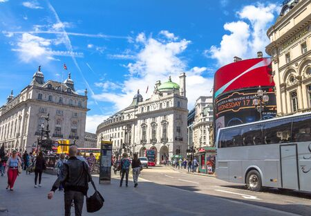 eros: View of Piccadilly Circus with unidentified tourists and locals in London. Billboards famous brands have been here for at least 20 years and are considered symbols of famous square. London, UK