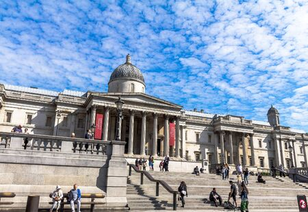 western european: Unidentified tourists near National Gallery in Trafalgar Square. The gallery houses a collection of Western European painting from the 13th to the 19th centuries. London, UK