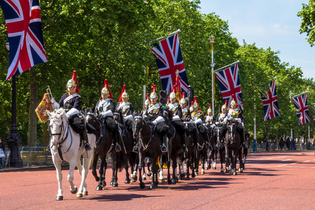 cavalry: Household Cavalry walk along The Mall in London, England, towards Buckingham Palace. The parade of the Horse Guards is very popular with visitors. Editorial