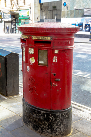 red post box: A vintage British red Post Box located in central London