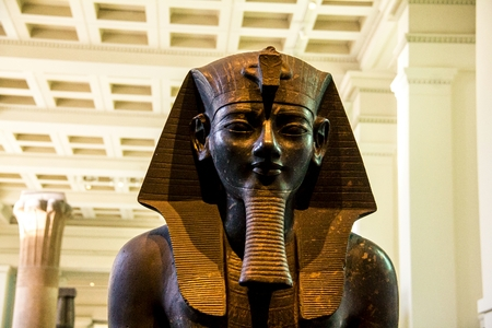 thebes: British Museum. Seated statue of Amenhotep III or Amenophis III. Thebes Egypt, about 1400 BC. Amenhophis III was the first Egyptian King to be worshipped as a god in his own lifetime. London, UK