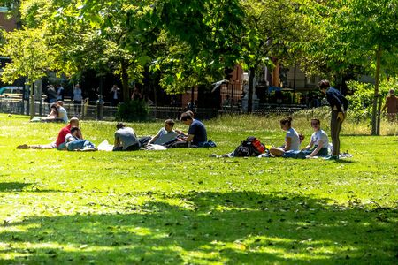st jamess: Unidentified young people is resting on the grass St. Jamess Park. London, UK Editorial