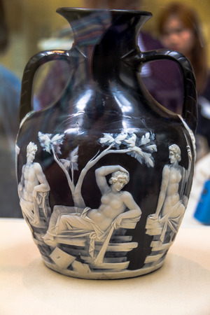scholarly: LONDON, UK - JUNE 4, 2015: British Museum.  Portland Vase is a Roman cameo glass vase, which is dated to between AD 15 and AD 25, though low BC dates have some scholarly support.